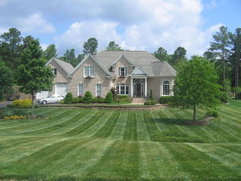 Triangle home with landscaped lawn