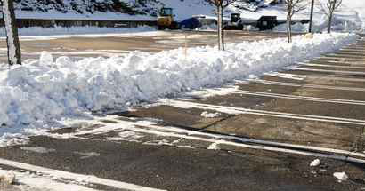 snow and ice removal in a parking lot